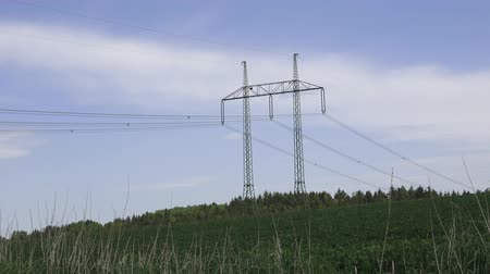pilon : Large view on the powerlines on the field. High voltage post or high voltage tower in field.
