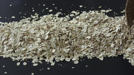 yulaf ezmesi : Dry rolled oatmeal isolated on black background Stok Video