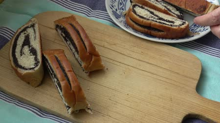 makowiec : Cut tasty sweet bun with poppy seeds