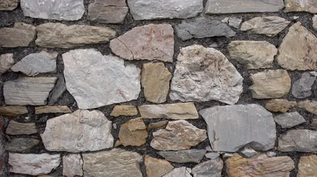 кирпичная кладка : Old castle stone wall.Texture of a stone wall Стоковые видеозаписи