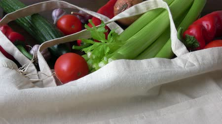 Eco bag with vegetables.Zero waste use less plastic concept. Fresh Organic Vegetables in Cotton Fabric Bags on Wooden Table