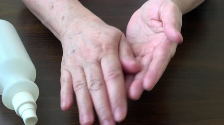 Spraying antiseptic solution on hands. Hand and skin disinfection