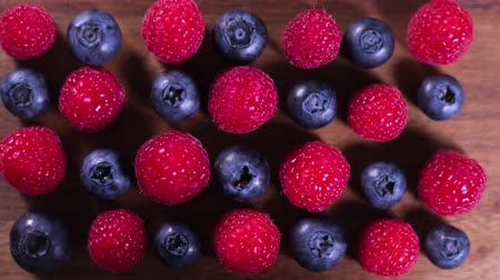 Raspberry and blueberry berries close up. Healthy nutrition. Stop motion.