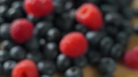 Raspberry and blueberry berries close up. Healthy nutrition. Vídeos