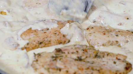 Chicken breast cooked in cream sauce. Mixing.