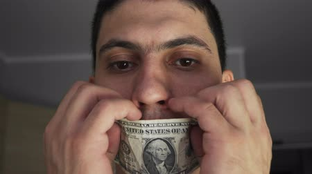 witness : The guy with the mouth sealed with dollar breaks it. The theme of bribery and corruption. The extortion. Close-up. Fee for silence. Portrait Stock Footage