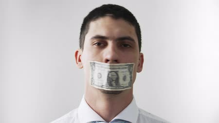 łapówka : The guy with the sealed mouth money bill shows no nodding here and there. The theme of bribery and corruption. Money is evil. On a white background