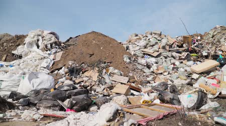 anyagi : Pollution concept. Garbage pile in trash dump or landfill. Global damage environmental. Construction debris. Slow motion. Shooting on the steadicam