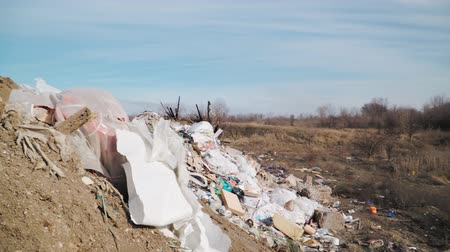 плохо : Pollution concept. Garbage pile in trash dump or landfill. Global damage environmental. Construction debris. Slow motion. Shooting on the steadicam