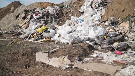 барахло : Big piles of garbage. Empty bottles, plastic in the waste dump. Pollution concept. Garbage heap in trash junkyard or landfill. Shooting on the steadicam Стоковые видеозаписи