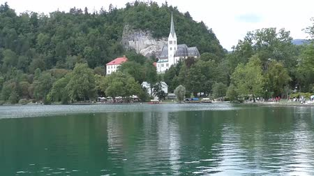 slovinsko : view on church and lake bled in slovenia