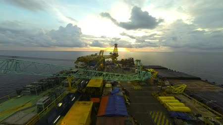 talapzat : Time lapse of beautiful sunset on accommodation and pipelay barge at South China Sea