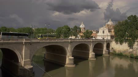 ROME, ITALY - JUNE 2015  View over the Ponte Cavour bridge over Tiber river in Rome, Italy on a beautiful day with dramatic clouds. People are doing their daily commute to work. Stock Footage