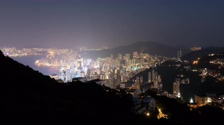 A timelapse of the city of Hong Kong as seen from Victoria Peak. Day to night, also called The Holy Grail of timelapse. Stock Footage