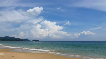 KARON BEACH, THAILAND - APRIL 24 2015 - Timelapse of the beautiful Karon Beach in Phuket, Thailand. Tourists are walking by and clouds are moving quickly on the sky. Stock Footage