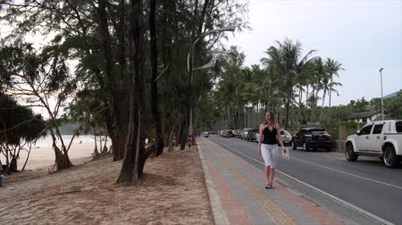 PHUKET, THAILAND - APRIL 25 2015 - People walking and traffic on Kata Road in Phuket, Thailand right before sunset. Timelapse. Stock Footage