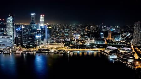 Time lapse of the Singapore skyline, western part, at night. Brands and trademarks have been blurred.