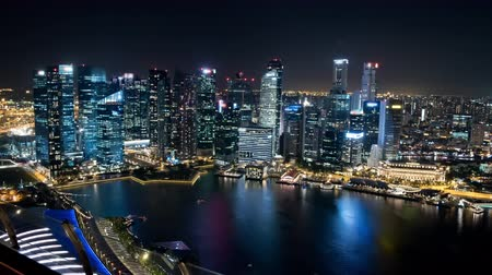 Time lapse of the Singapore skyline, western part, at night. Brands and trademarks have been blurred. Clip 2. Stock Footage