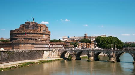 Time lapse of the Mausoleum of Hadrian (Castel Sant'Angelo) in Rome, Italy (exterior). You also see the Bridge of Hadrian to the right, crossing the Tiber river.