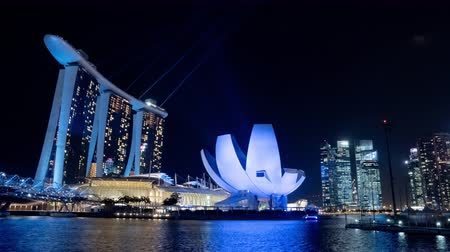 SINGAPORE, APRIL 2015 - Time lapse of the eastern part of the magnificent Singapore skyline with the Marina Bay Sands Hotel and the light show.