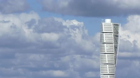 MALMO, SWEDEN - MAY 2 2015 - The magnificent Turning Torso skyscraper landmark in Malmo, Sweden, against a cloudy sky in May 2015. Stock Footage