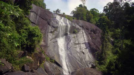 Cinemagraph of The Seven Wells Waterfall, or Telaga Tujuh, in Langkawi, Malaysia. Video loop, motion background with perfectly seamless endless infinity repeat. Beautiful tropical nature.