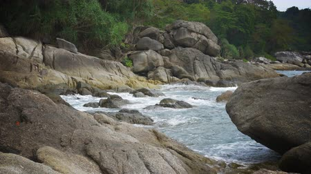 Cinemagraph (seamless moving motion background loop) of waves breaking against rocks in Southeast Asia (Thailand).
