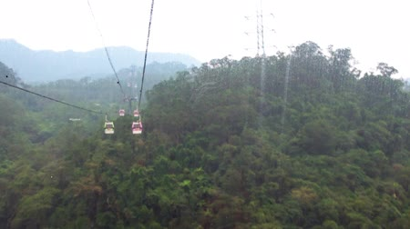 POV Hyperlapse (motion time lapse) of the Maokong Gondola (aerial sky lift) in Taipei, Taiwan that goes above Taipei Zoo. You see jungle and Taipei mountains. First person point of view timelapse. Stock Footage