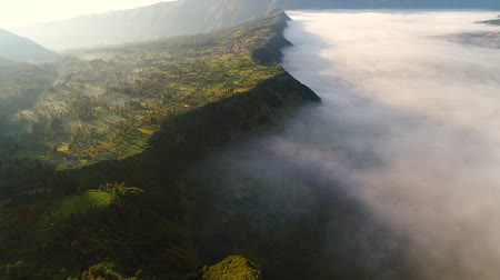 dağ evi : Aerial view flight over Cemoro Lawang, small village in morning mist. Which situated on the edge of massive north-east of Mount Bromo, East Java, Indonesia