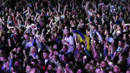 estádio : KYIV, UKRAINE - MAY 20, 2015: Crowd of people enjoy gala concert in honor of Dynamo Kyiv football team at Olimpiyskiy stadium