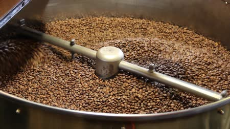 organic : Freshly roasted coffee beans mixing in a coffee roaster