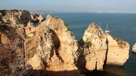 ponta da piedade : Rocks of Ponta da Piedade and Atlantic ocean coast in Lagos, Algarve, Portugal Stock Footage
