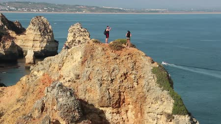 ponta da piedade : Tourists take photo on the view point of Ponta da Piedade in Lagos, Algarve, Portugal Stock Footage
