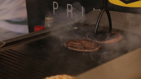 schab : Two Fresh meat cutlets in a frying pan grill