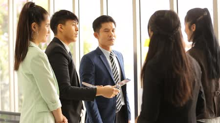post room : Asian business team standing talking work in office room Stock Footage