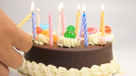 buttercream : lighting candles on birthday cake Stock Footage