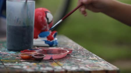 artistik : Portrait of little girl summer painting outdoor in park