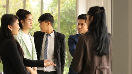 post room : Asian business people team standing talking work in office room Stock Footage
