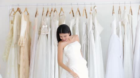 vállfa : Asian women cheerful happiness in wedding fashion store Stock mozgókép