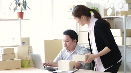 sme : Lifestyle business couple sitting in office looking screen laptop happy working, SME small business Stock Footage