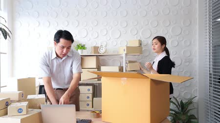 sme : Business couple receive Order form customer in tablet, Checking box delivery and note. Stock Footage