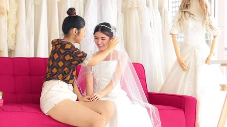 축하 해요 : Asian designer working in wedding fashion store shop,Friendship congratulations to the wedding