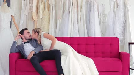 engaged : Beautiful model wedding couple sitting on sofa men sleeping,Love concept men kiss women