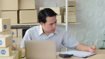 sme : Business man receive order from customer in tablet, Checking box delivery and note. Stock Footage