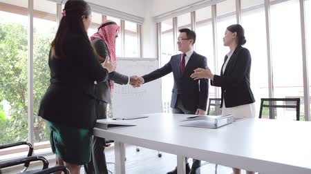 blahopřání : Business meeting Asian team and Arabic man standing handshake congratulations in office room