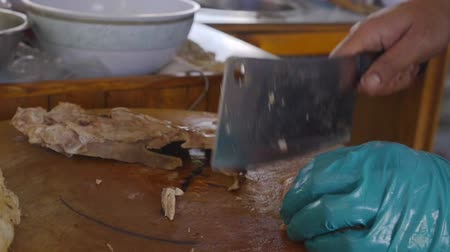 peking : Slow motion Chef slices peking duck asian food