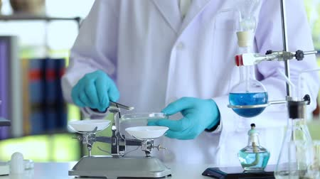 scrutiny : Scientist working at lab using tool counting drug Stock Footage