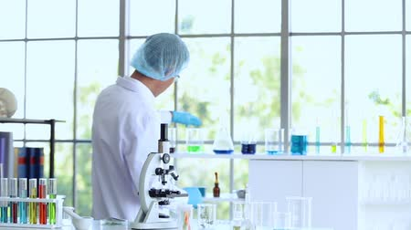 speculate : Chemistry professordoctor holding tube are using ideas in a lab science Stock Footage