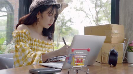 small pen : Asian young woman start up small business SME or freelance working at home