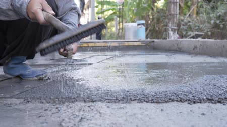 cement floor : Industry construction man builder washed gravel on floor